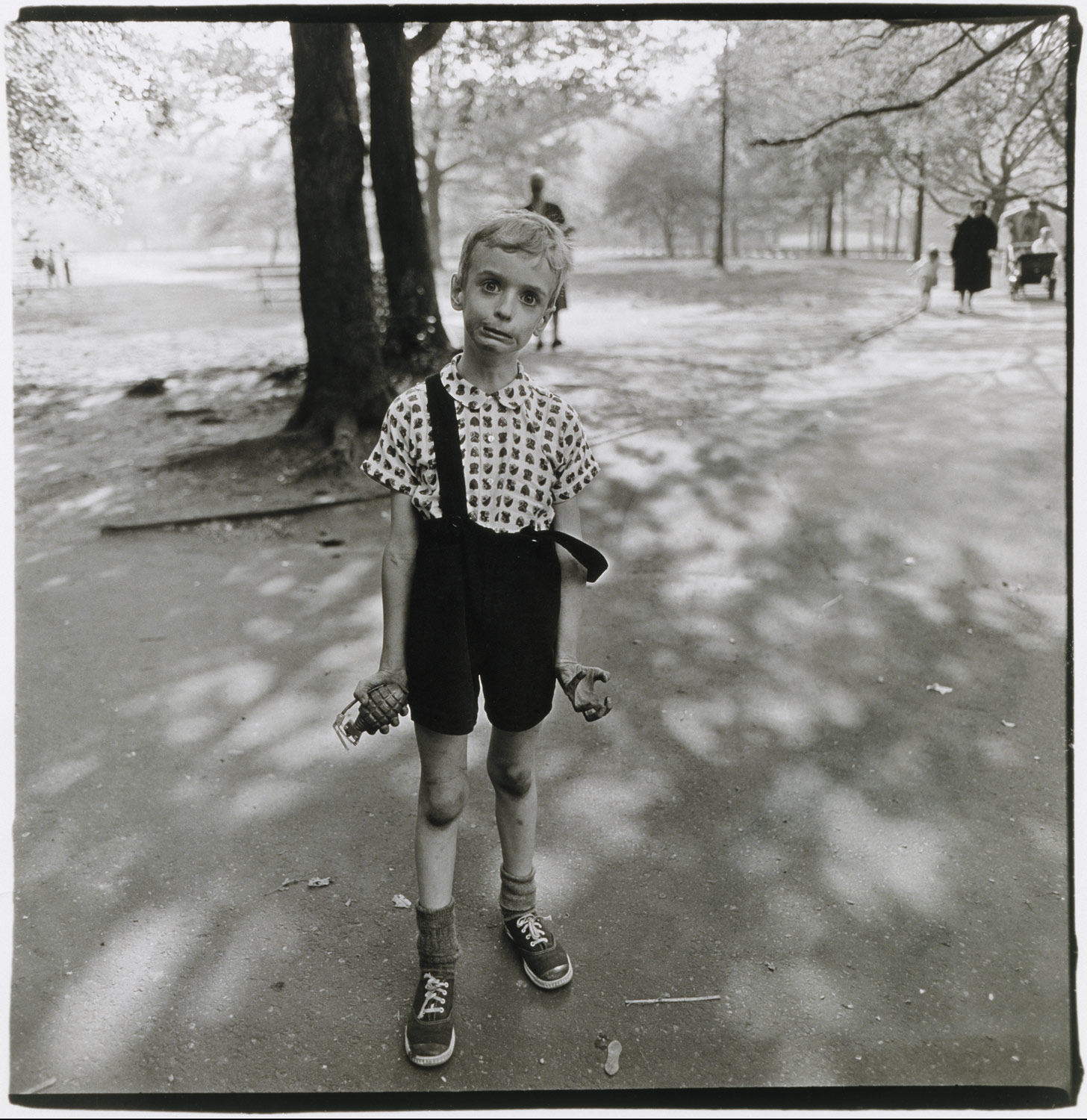Child with a toy handgranade in Central Park